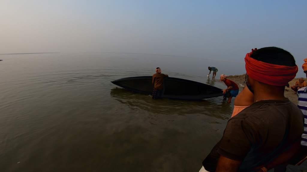 Helpful volunteers wash the boat